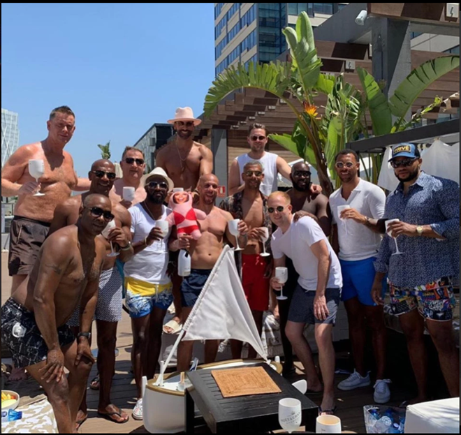 Rio Ferdinand poses with pals on stag do as Man Utd legend parties with blow up doll of Kate Wright - Bóng Đá