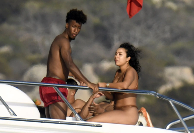 Kingsley Coman straddled by stunning fiancee on boat as Bayern Munich's Champions League hero relaxes in Sardinia - Bóng Đá