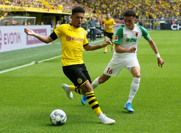 Jadon Sancho seals bumper new £190,000-a-week contract at Borussia Dortmund with Manchester City and Manchester United circling - Bóng Đá