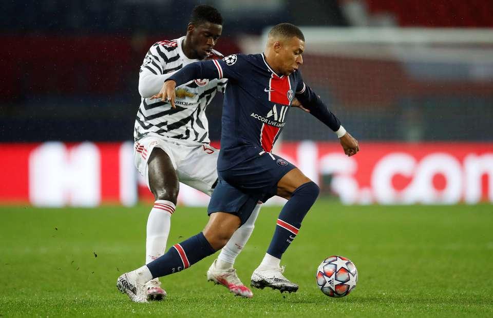 Fans hail Axel Tuanzebe for 'pocketing' Kylian Mbappe - Bóng Đá