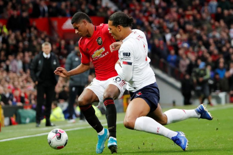 Rafael admits it would be 'great' for Manchester United if Liverpool miss out on Premier League title - Bóng Đá