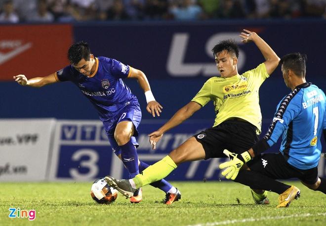 Quang Hải đổ máu, Hà Nội FC giành chiến thắng nhọc trước Bình Dương - Bóng Đá