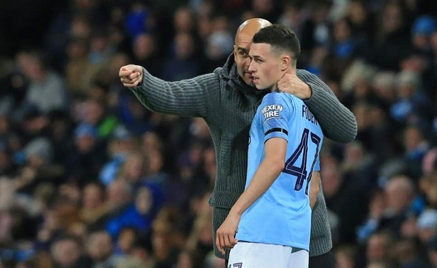 Manchester City teenager Phil Foden is willing to join Real Madrid but Pep Guardiola has no intentions of letting him leave the club - Bóng Đá