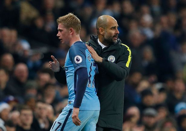 Manchester-Citys-Kevin-De-Bruyne-with-manager-Pep-Guardiola-as-he-is-substituted
