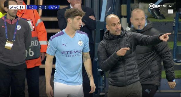 Furious Pep Guardiola shouts at John Stones and slams seat in fit of rage - Bóng Đá