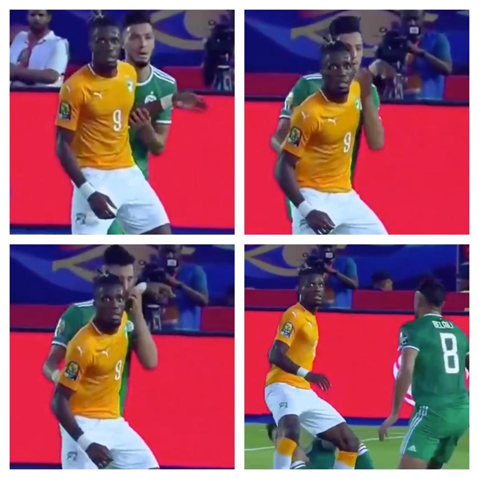 Algeria defender Ramy Bensebaini smacked himself in the face with Wilfried Zaha's hand - Bóng Đá