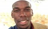Mặc tin đồn rời M.U, Pogba tươi cười đến với đất Thánh