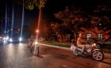 Cảnh sát hộ tống CLB Hà Nội rời sân Thiên Trường
