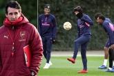 Cái lạnh khiến Ozil co rúm trong ngày trở lại sân tập Arsenal