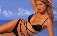 Heidi Klum dùng tay e ấp che ngực lấp ló