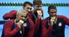 Lý do nhà vô địch Olympic luôn cắn huy chương vàng