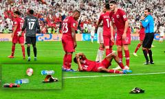 AFC vào cuộc điều tra hành vi ném giày dép vào ĐT Qatar của CĐV UAE