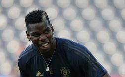 Pogba cười sặc sụa trước tin đồn Ronaldo đề nghị Juve chiêu mộ anh