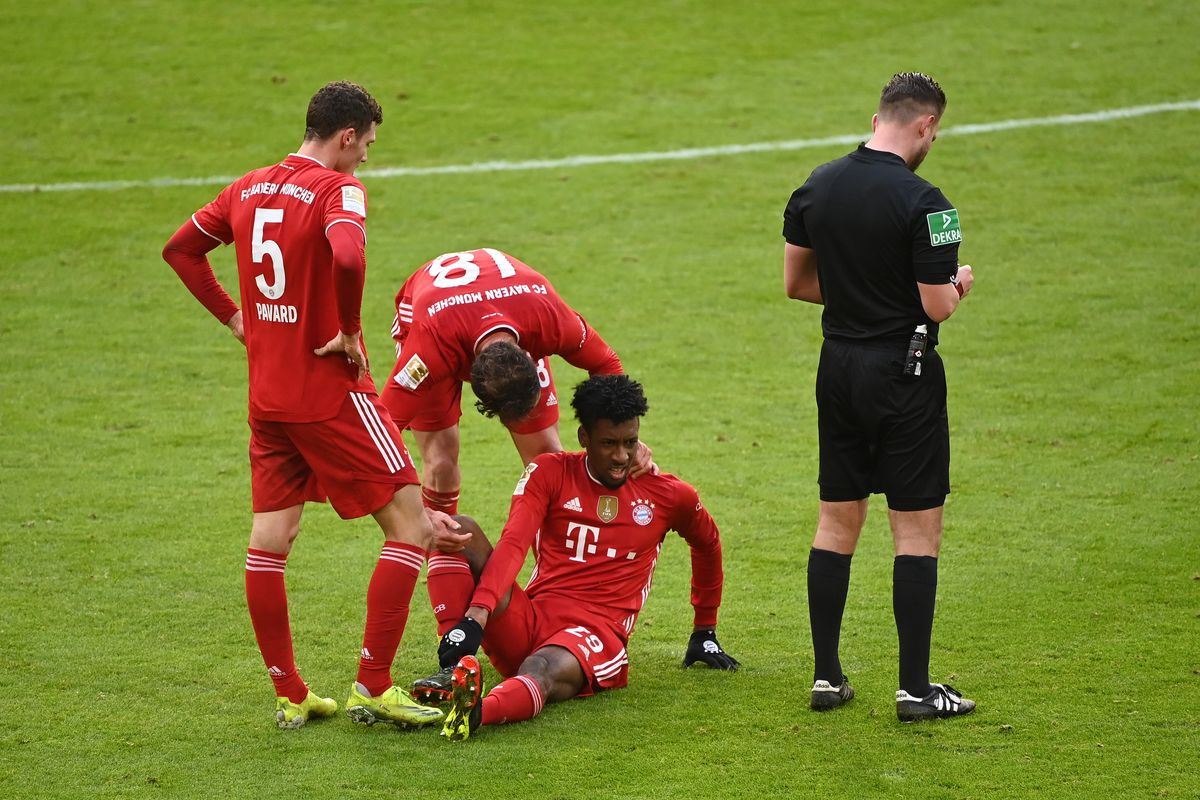 Kingsley Coman went to ground in evident pain. - Bóng Đá