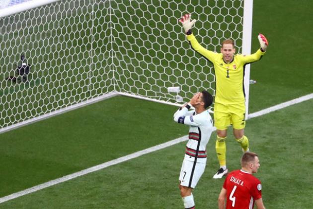 Ronaldo lập công chuộc tội, Bồ Đào Nha vượt ải Hungary - Bóng Đá